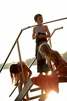 Children playing on the jetty in the evening, Lake Woerthsee, Upper Bavaria, Bavaria, Germany