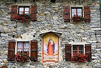 Fascade with picture of the Virgin Mary, Sonogno, Valle Verzasca, Canton of Ticino, Switzerland