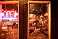 People drinking beer in the T_Bar pub, Castle Mountain ski resort, Alberta, Canada