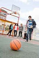 Teenagers in basketball court