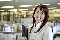 Businesswoman holding a folder, portrait