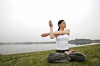 View of a young woman practicing yoga