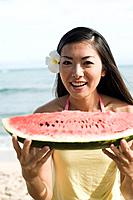 Portrait of a young woman holding watermelon