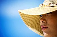 Close-up of a woman wearing hat