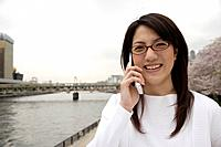 Close-up of a young woman using mobile phone
