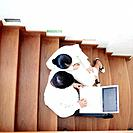 High angle view of a businessman and businesswoman sitting together on a staircase