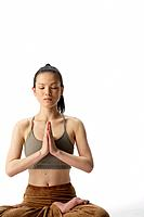 Front view of a young woman meditating in lotus position