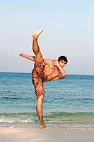 Asia, Thailand, Young man kick_boxing