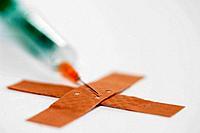 Syringe and band_aid