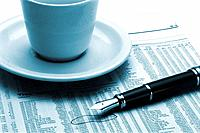 an executive table with coffee cup