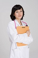 Young doctor holding file, portrait