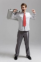 Cheerful businessman holding briefcase