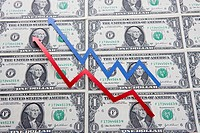 Close_up of arrow signs over US paper currency