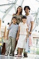 Family standing in mall smiling selective focus
