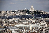 France. Paris. The city scape of Paris with Sacre_Coeur basilica in Montmartre in the background.