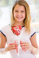 Young girl on Valentine´s Day holding love themed balloon smiling