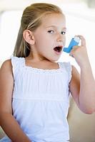 Girl Using An Inhaler