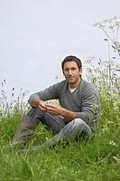 Man sitting in field portrait