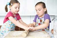 Two girls 5_6 rolling dough