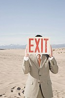 Man in desert with exit sign