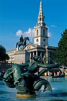 England _ London _ St James´s district _ sculpture and fountain at Trafalgar Square with Church of St Martin in background
