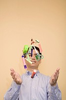 Close_up of a young man tossing stationery objects