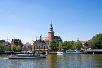 Passenger boats in river with city hall in background, Leer, Lower Saxony, Germany