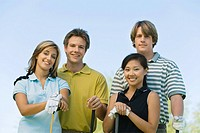 Two couples of golfers posing on golf course portrait