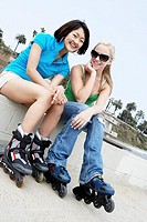 Two rollerblades sitting outside