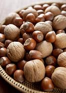 Walnuts and hazelnuts on a basketwork tray