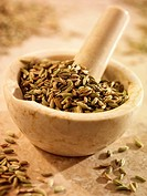 Fennel seeds in and beside a mortar