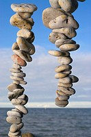 Stacks of pebbles with sea in the background