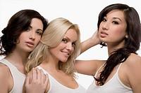 Portrait of three young women posing