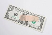 Adhesive bandage on a US dollar bill