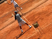 Two male tennis players playing tennis