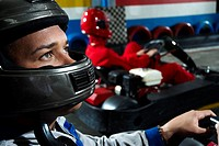 Close_up of a male go_cart racer in a sports car