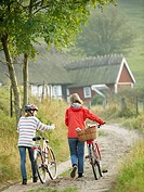 Girl and woman on bicycletrip, Österlen, Skåne, Sweden