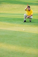 Golfer Lining Up Put