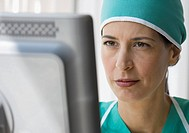 Female doctor looking at computer