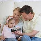 Family looking at video camera