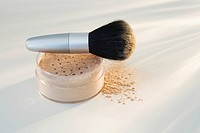 Powdered mineral makeup and brush