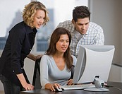 Multi_ethnic businesspeople looking at computer