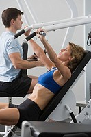 Couple exercising at gym