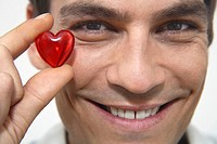 Man holding red heart, close_up