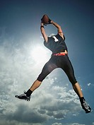 Low angle view of football player jumping