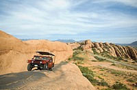 Off_road vehicle driving on rock formation