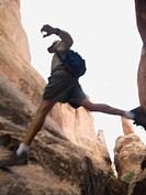 Man jumping over rock formations
