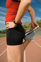 Female runner stretching, Utah, United States