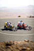 Spain, Canary Islands, Fuerteventura, tourists on trikes