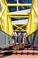 Germany, Baden Württemberg, Stuttgart, Business people walking on bridge